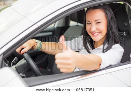 Female driver showing thumbs up