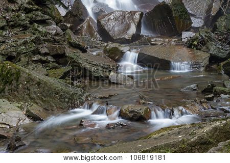 Water Flowing Over Stones. By Base Of Waterfall.