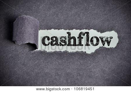 Cashflow Word Under Torn Black Sugar Paper