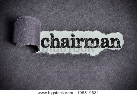Chairman Word Under Torn Black Sugar Paper