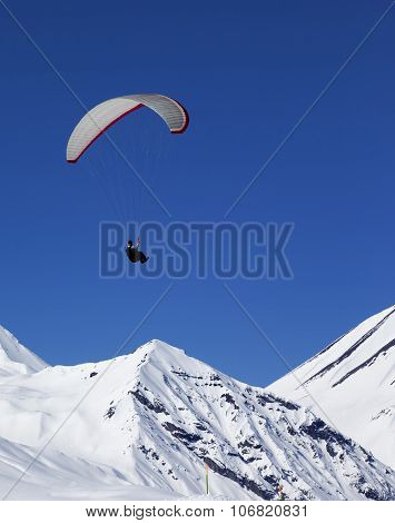 Paraglider In Sunny Snowy Mountains At Nice Day
