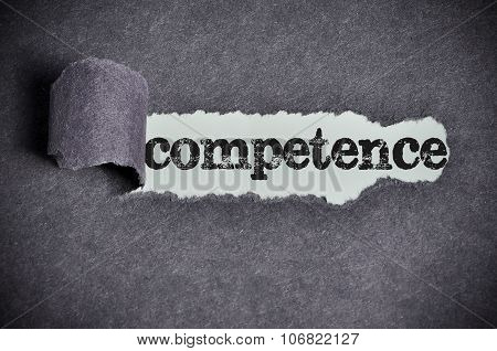 Competence Word Under Torn Black Sugar Paper