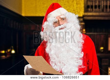 Santa Claus reading strange requests on a letter