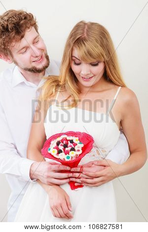 Loving Couple With Candy Bunch Flowers. Love.