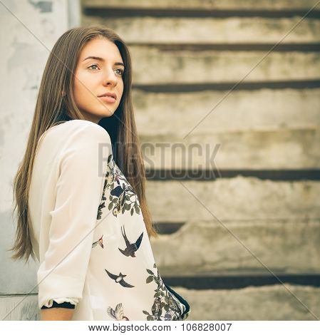 Urban Portrait Of Young Hipster Girl On Stairs