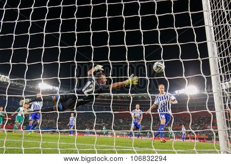 VIENNA, AUSTRIA - AUGUST 28, 2014: Antonio Doblas (#12 Helsinki) tries to catch the ball in an UEFA Europa League qualifying game.