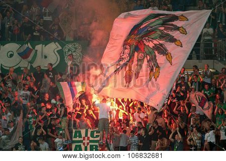 VIENNA, AUSTRIA - JULY 27, 2014: Fans of SK Rapid cheer on their team during a friendly game.