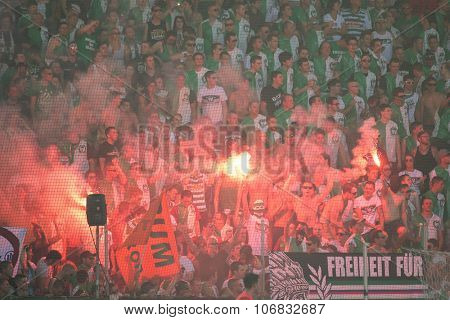 VIENNA, AUSTRIA - JULY 6, 2014: Fans of the SK Rapid celebrate the final at Gerhard Hanappi Stadium.