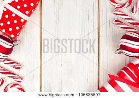 Red and white Christmas border on white wood
