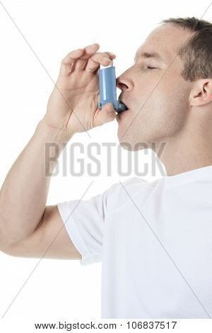 sport man using a asthma pump