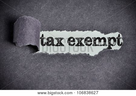Tax Exempt Word Under Torn Black Sugar Paper