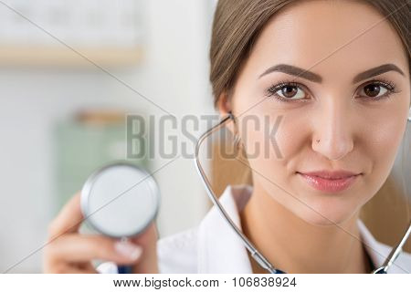 Portrait Of Female Doctor Holding Stethoscope Head