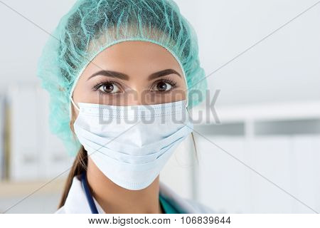 Close-up Portrait Of Female Medicine Doctor Wearing Protective Mask And Cup