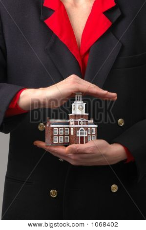Hands Holding Commercial Building