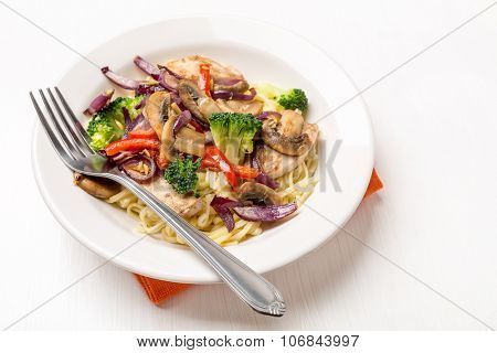 Stir-Fried Vegetables and Chicken Breast Served with Pasta