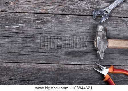 Different Construction Tools On A Wooden Background