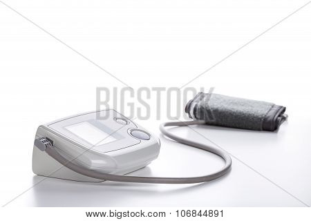 Digital Blood Pressure Monitor Closeup On White