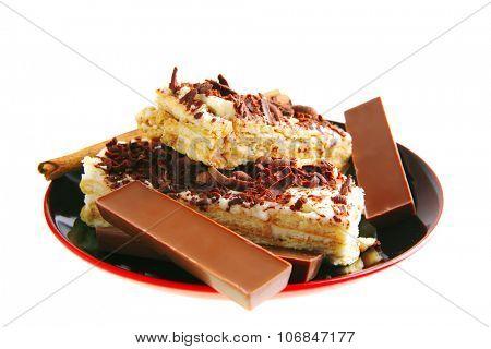 chocolate bars and cake with cinnamon on saucer