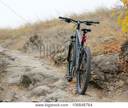 Mountain Bike on the Beautiful Autumn Rocky Trail. Active Lifestyle and Extreme Sports Concept.