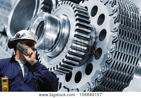 mechanic, engineer with giant cogwheels and gear machinery, engineering concept