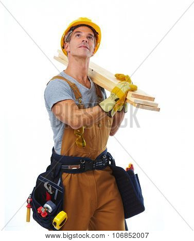 Construction worker with wood plank. House renovation background.