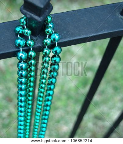 Couple beads aligned on fence in New Orleans in Lousiana after Mardi Gras