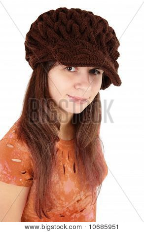 Nice girl in a brown cap