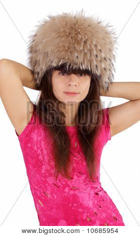 Beautiful young girl in a fur cap