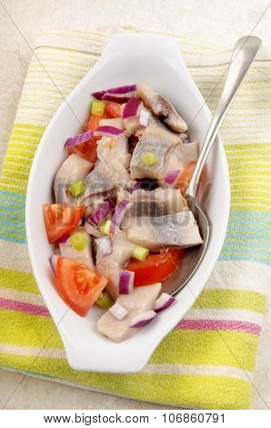 Herring Salad With Tomato, Purple Onion And Spring Onions