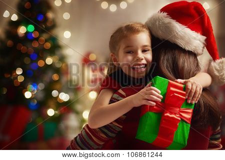 Mother and daughter exchanging Christmas gifts