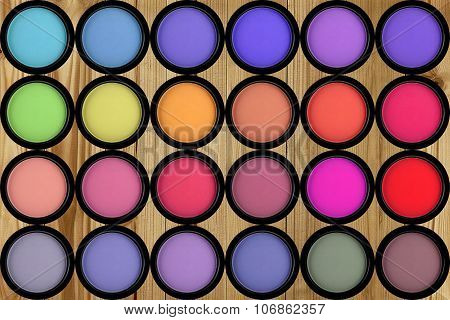 Set Multicolored Eye Shadows On Wooden Background