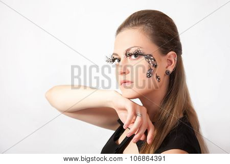 Beautiful Woman With Big Eyelashes And Face-art