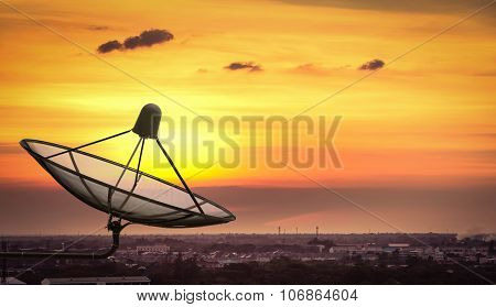 Satellite Dish In The City On Sunset.