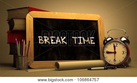 Hand Drawn Break Time on Chalkboard.
