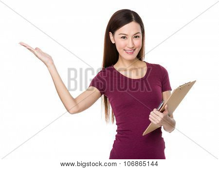 Asian Woman hold with clipbaord and open hand palm