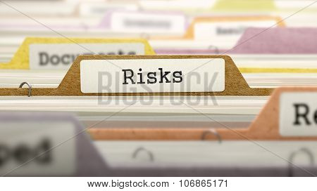 Risks Concept. Folders in Catalog.