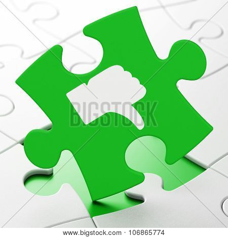 Social network concept: Thumb Down on puzzle background