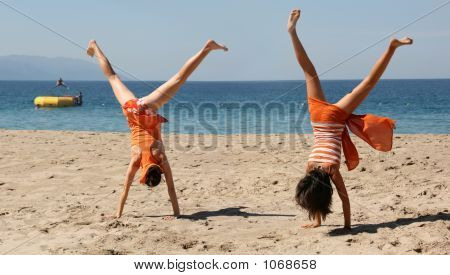 Two Girls Doing Cartwheel
