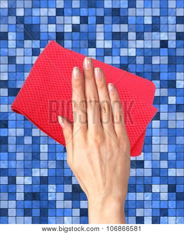 Hand Wiping Color Tile With Red Rag