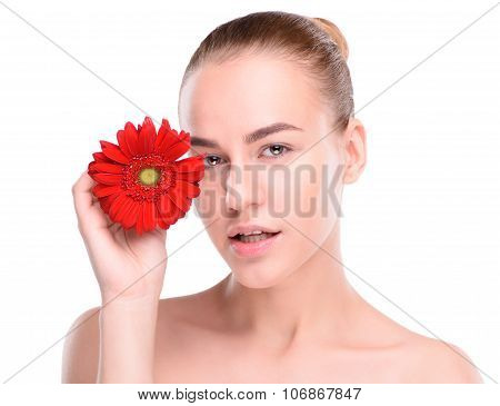 Woman posing with red gerbera. Isolated on white background