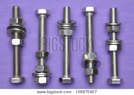 Bolts and nuts on violet background