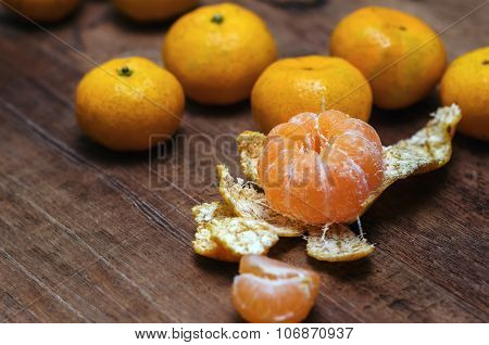 Ripe mandarines on wooden background