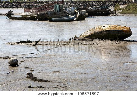 Ship Wrecks Falling Dry At Low Tide In Noirmoutier