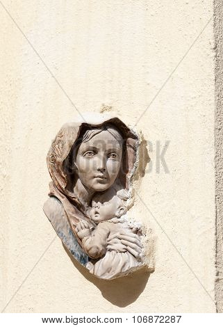 Bas-relief Of The Virgin And Child On The Front Wall Of Building In Malta Capital - Valletta, Europe
