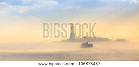 Staten Island Ferry cruises past the Statue of Liberty.