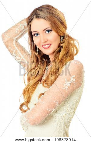 Beautiful young woman with long hair. Make-up, cosmetics. Jewelry. Haircare. Isolated over white.
