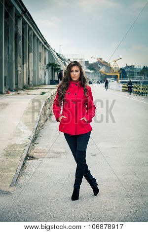 young woman in red short coat, pants and high heels boots,  outdoor on  street,  full body shot