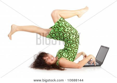 The flexible beautiful girl with the laptop on a white background