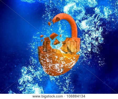 Rusted opened padlock under blue clear water