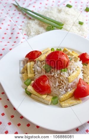 vegetable risotto served on chequered tablecloth